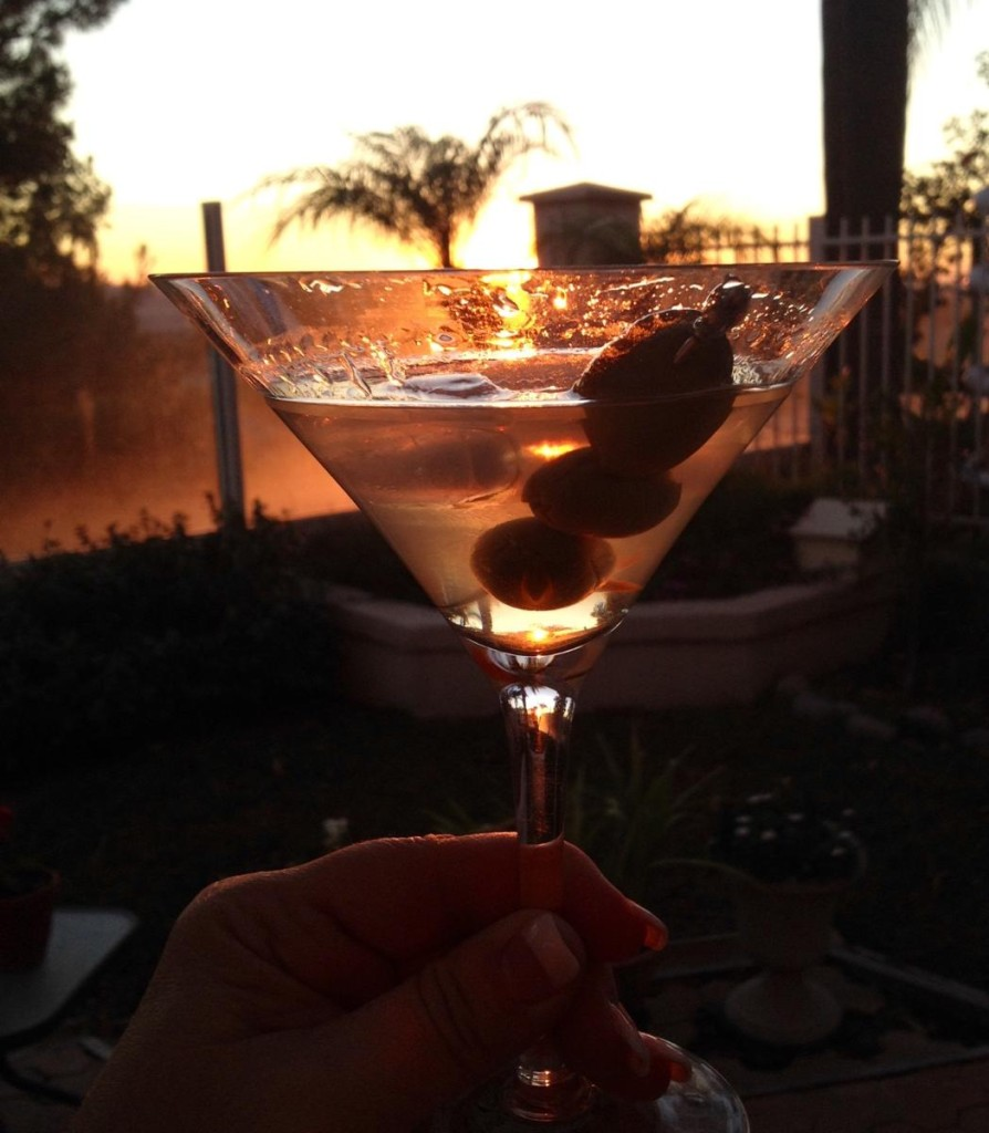 Enjoying a Martini at Sunset overlooking the ocean.